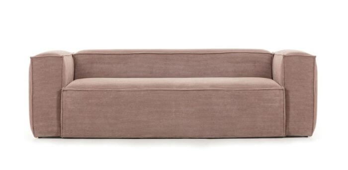 Lyserød sofa i bredriflet fløjl