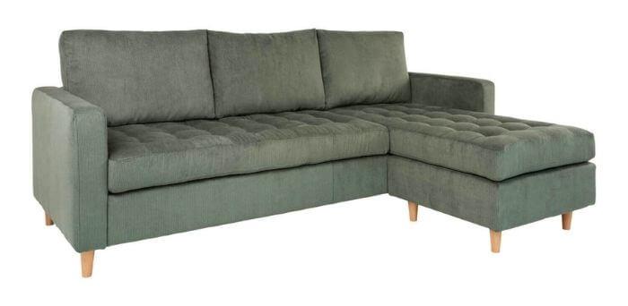 Grøn sofa i bredriflet fløjl