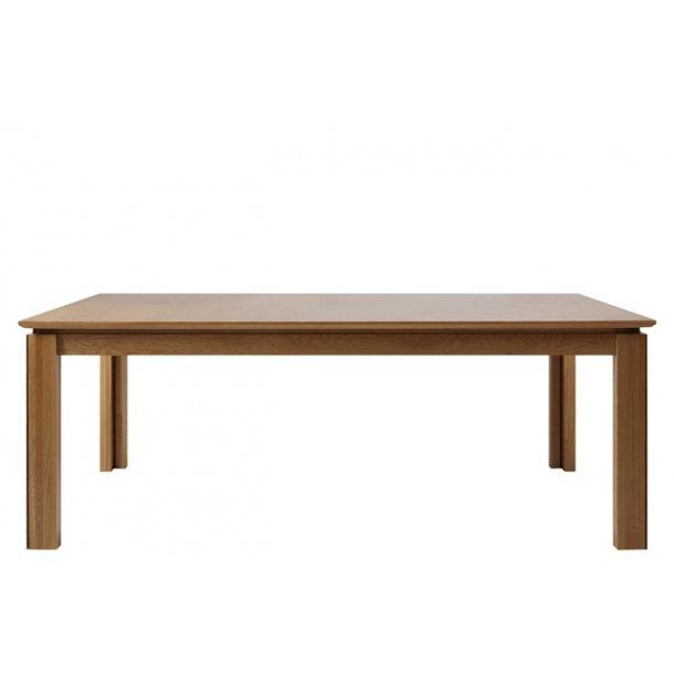Langbord med 4 tillægsplader. Find dit lange spisebord her -->