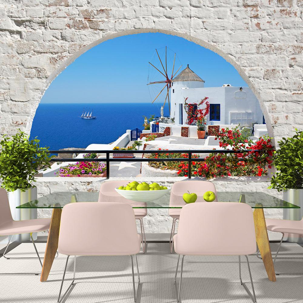 ARTGEIST fototapet - Summer in Santorini, Santorini set gennem vindue (flere størrelser) 100x70